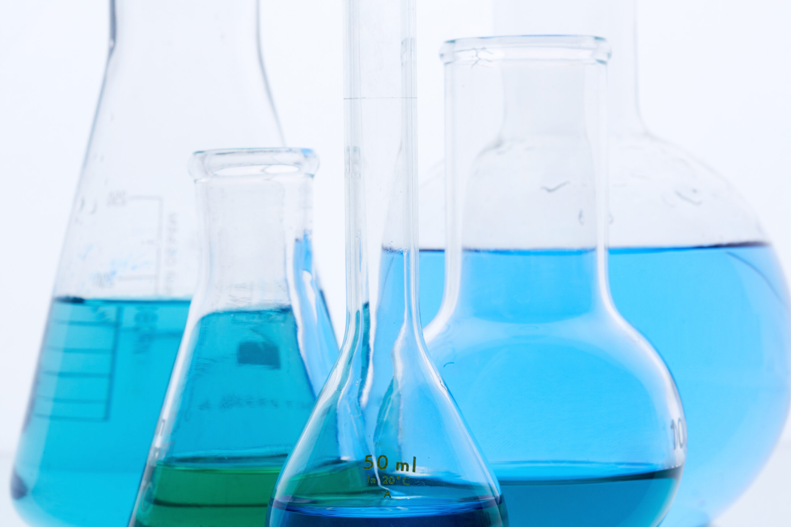beakers filled with blue liquid